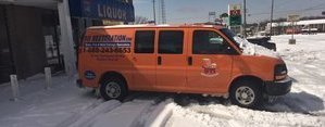 Water Damage Restoration Van In Snow At Commerical Job Site
