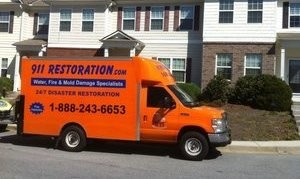 Water Damage Restoration Truck At Townhouse