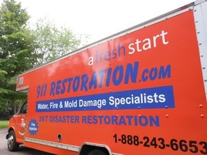 Water Damage Nineveh Restoration Truck Parked At Residential Job Site