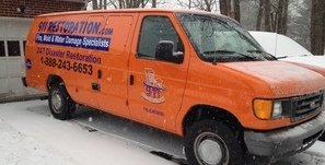 Mold Damage Restoration Van At Winter Residential Job Site